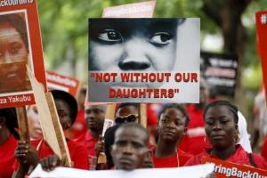 Bring Back Our Girls (BBOG) campaigners hold banners as they walk during a protest procession marking the 500th day since the abduction of girls in Chibok, along a road in Lagos August 27, 2015. Reuters/Akintunde Akinleye