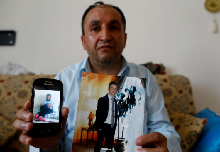 Tahir Kipcak shows photographs of his son Murat during an interview with Reuters in Istanbul, Turkey, May 31, 2016. Credit: Reuters/Osman Orsal