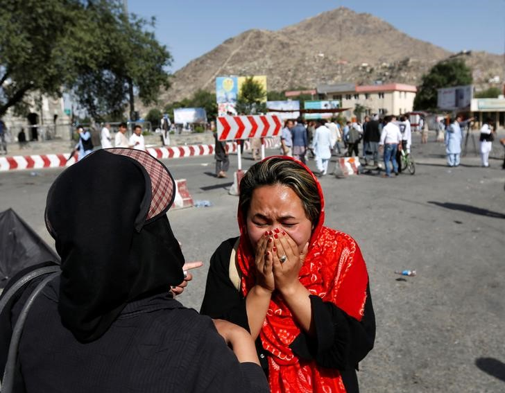 An Afghan woman weeps at the site of a suicide attack in Kabul, Afghanistan July 23, 2016. Credit: REUTERS/Mohammad Ismail