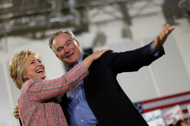 Democratic US presidential candidate Hillary Clinton and US senator Tim Kaine react during a campaign rally at Ernst Community Cultural Center in Annandale, Virginia, US, July 14, 2016. Credit: Reuters/Carlos Barria