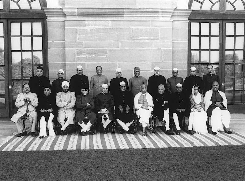 (L to R sitting) B.R. Ambedkar, Rafi Ahmed Kidwai, Sardar Baldev Singh, Maulana Abul Kalam Azad, Jawaharlal Nehru, Rajendra Prasad, Sardar Patel, John Mathai, Jagjivan Ram, Amrit Kaur and Syama Prasad Mukherjee. (L to R standing) Khurshed Lal, R.R. Diwakar, Mohanlal Saksena, N. Gopalaswami Ayyangar, N.V. Gadgil, K. C. Neogy, Jairamdas Daulatram, K. Santhanam, Satya Narayan Sinha and B. V. Keskar. Credit: Wikimedia Commons