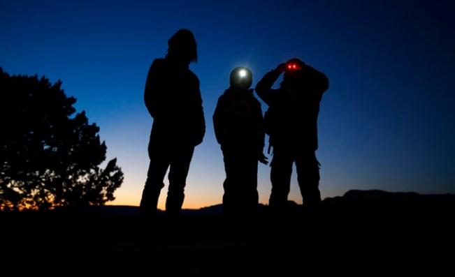 As darkness fall in the Arizona desert three boys await the arrival of UFO hunter Kim Carlsberg of UFO Sky Tours to begin their search outside Sedona, Arizona February 14, 2013. Credit: Reuters/Mike Blake