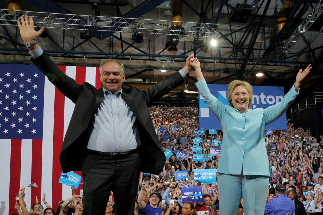 US Democratic presidential candidate Hillary Clinton and Democratic vice presidential candidate Senator Tim Kaine take the stage at a campaign rally in Miami, Florida, U.S. July 23, 2016. Credit: Reuters