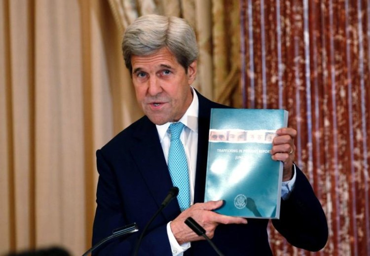 US Secretary of State John Kerry holds up a copy of the 2016 Trafficking in Persons (TIP) report during the TIP Heroes Ceremony at the state department in Washington, June 30, 2016. Credit: Reuters/Kevin Lamarque