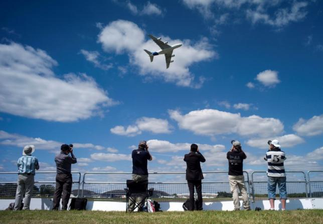The Airbus Industrie A380 aircraft performs a manoeuvre during its display at the 2014 Farnborough International Airshow in Farnborough, southern England July 14, 2014. Credit: Reuters/Kieran Doherty