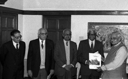 Atal Bihari Vajpayee is presented with theKargil Review Committee report by K. Subrahmanyam and other committee members, in New Delhi on January 7, 2000.Credit: PIB