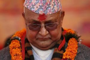 Nepal's prime minister Khadga Prasad Sharma Oli, also known as KP Oli, observes a minute of silence for earthquake victims during an event organised to mark the 18th National Earthquake Safety Day and the official launch of earthquake reconstruction efforts in Bungamati village, Nepal January 16, 2016. Credit: Reuters/Navesh Chitrakar