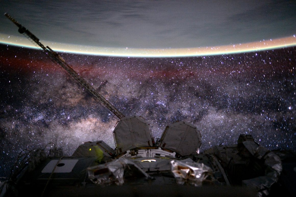 A view of the Milky Way's central band of stars from the ISS, with Earth visible on top. Credit: NASA