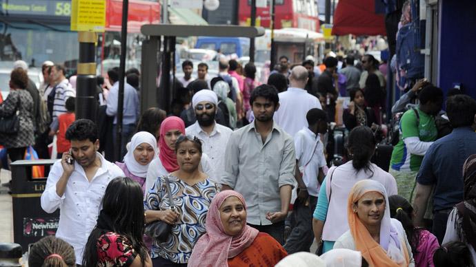 Shoppers walk in a market in the Upton Park neighborhood in east London. Credit: Reuters/Paul Hackett