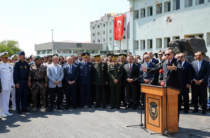 Turkey's President Tayyip Erdogan addresses the audience as he visits the Turkish police special forces base damaged by fighting during a coup attempt in Ankara, Turkey, July 29, 2016. Kayhan Ozer/Courtesy of Presidential Palace via Reauters/Files