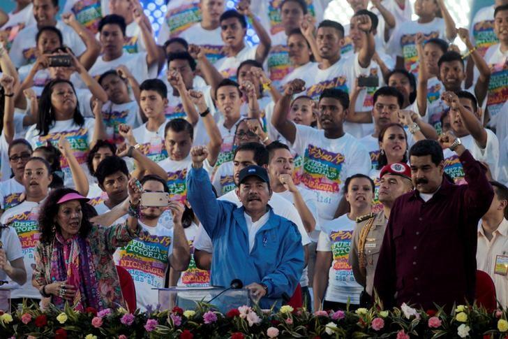 Nicaragua's President Daniel Ortega (L) and Venezuela's President Nicolas Maduro greet supporters during the celebrations to mark the 37th anniversary of the Sandinista Revolution at the Juan Pablo II square in Managua, Nicaragua July 19, 2016. Credit: REUTERS/Oswaldo Rivas/Files