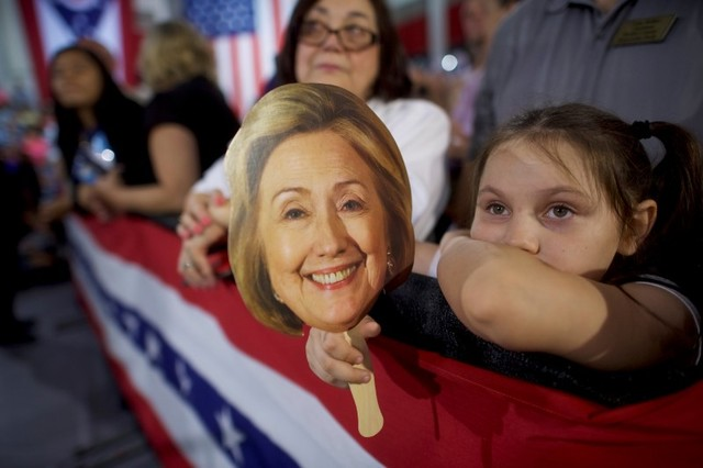 Supporter Hunter Lassus awaits the arrival of US Democratic presidential nominee Hillary Clinton for a rally at John Marshall High School in Cleveland, Ohio August 17, 2016. Credit: Reuters/Mark Makela