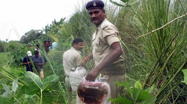 Policemen recoverd poisonous liquor in a field at Harkhua Khajurbari Village in Gopalganj district of Bihar on Wednesday. Credit: PTI