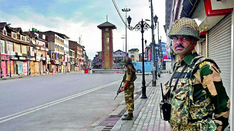 Border Security Forces in Srinagar during a curfew. Credit: PTI