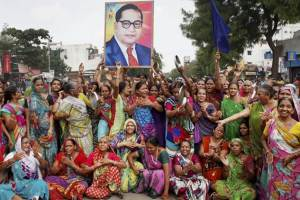 Women Dalit protestors in Gujarat carrying a portrait of B.R. Ambedkar. Credit: PTI