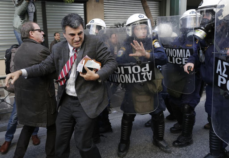 Riot police push protesters during clashes outside the Labor Ministry in Athens in this January 30, 2013 file picture. Credit: John Kolesidis, Reuters