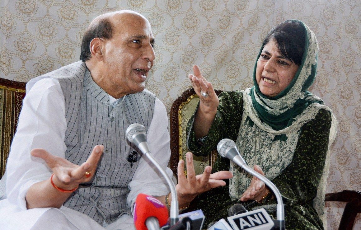 File photo of Union home minister Rajnath Singh and Jammu and Kashmir chief minister Mehbooba Mufti. Credit: PTI/S. Irfan