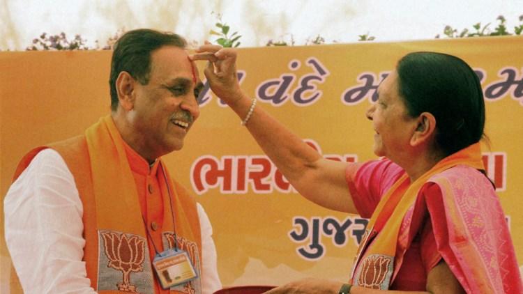 File photograph of Gujarat chief minister-designate Vijay Rupani and Anandiben Patel. Credit: PTI
