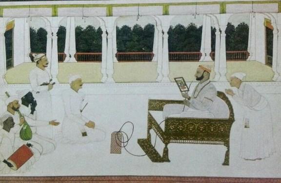 Raja Balwant Singh of Jasrota viewing a painting by Nainsukh (R). Pahari painting, early-18th century. Courtesy: Pratyay Nath/Kangrakalam.blogspot.in