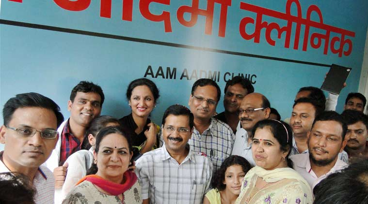 Delhi Chief Minister Arvind Kejriwal pose for photographs during the inauguration of the first mohalla clinic in New Delhi. Credit: PTI/Files