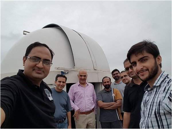 Mohammad Mehdi Hussein (front left) and members of KAS in front of their home-built dome that houses a 12.5-inch telescope. Khalid Marwat (centre), a former Air Force pilot, is one of the first serious amateur astronomers of Pakistan. Credit: The Friday Times