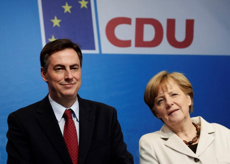 Leader of the Christian Democratic Union (CDU) party and German Chancellor Angela Merkel (R) and CDU top candidate David McAllister attend an election rally in Berlin May 14, 2014. Credit: Reuters