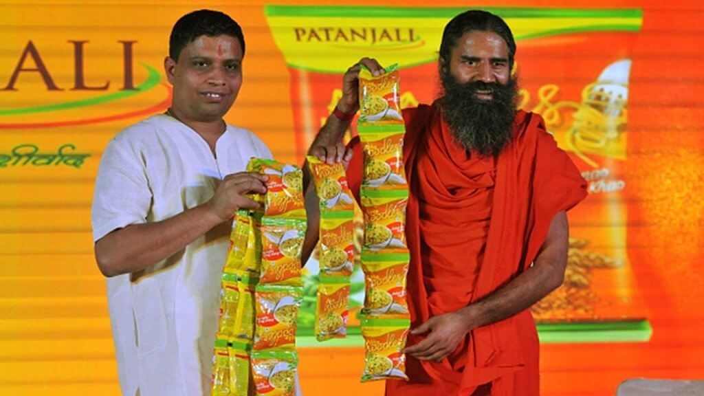 File photo of Acharya Balkrishna and Baba Ramdev of Patanjali Ayurveda. Credit: PTI