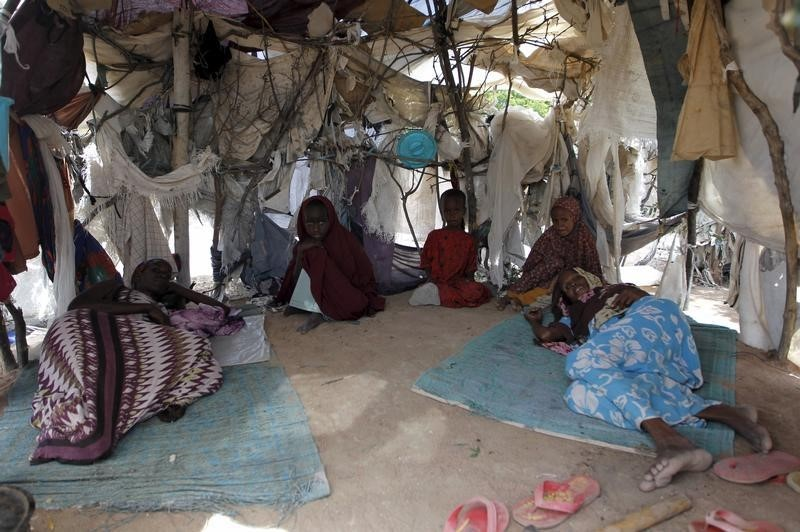 A Somali refugee family is pictured inside their makeshift shelter at the Ifo camp in Dadaab near the Kenya-Somalia border, May 8, 2015. Credit: Reuters