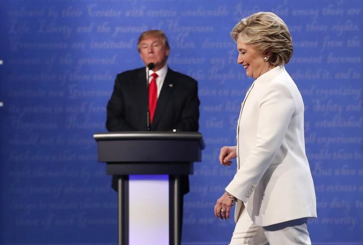 Democratic U.S. presidential nominee Hillary Clinton walks off the debate stage as Republican U.S. presidential nominee Donald Trump remains at his podium after the conclusion of their third and final 2016 presidential campaign debate at UNLV in Las Vegas, Nevada, U.S., October 19, 2016. Credit: REUTERS/Rick Wilking
