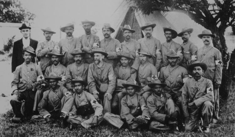 Mahatma Gandhi with the stretcher-bearers of the Indian Ambulance Corps during the Boer War, South-Africa. Credit: Wikimedia Commons