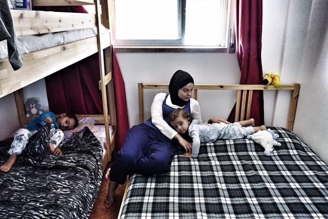 Nairouz putting the children to sleep. Credit: Shome Basu