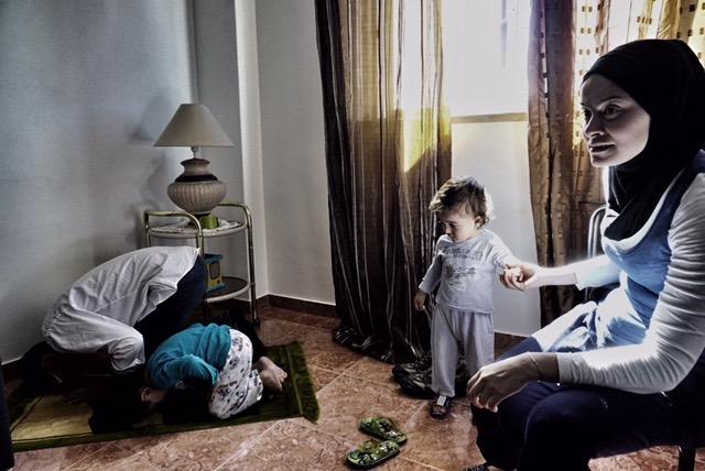Aleed and Lokman pray as Nairouz and Ivan look on. Credit: Shome Basu
