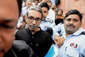New Delhi: Jawaharlal Nehru University (JNU) Vice-Chancellor M. Jagadesh Kumar coming out of his office at JNU on Thursday after being gheraoed by students protesting over missing varsity student Najeeb Ahmed. Credit: PTI (PTI10_20_2016_000287B)