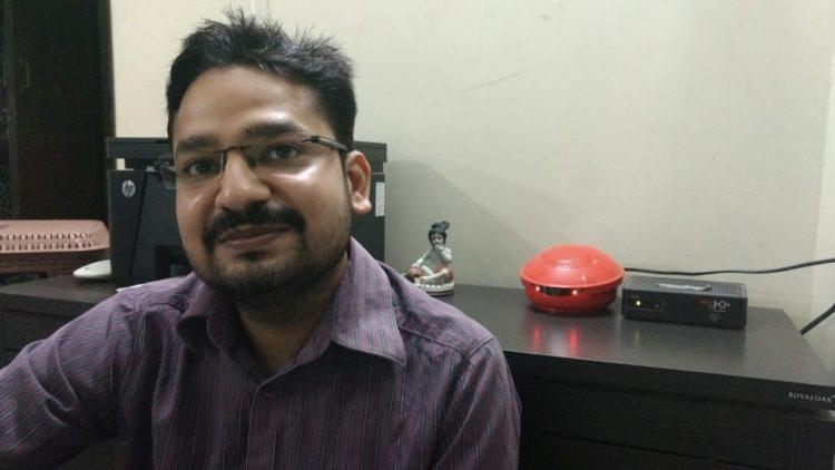 Kush in his room, with the idol of Krishna in the background. Credit: Sangeeta Barooah Pisharoty