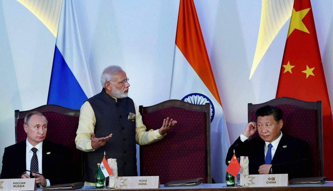 Prime Minister Narendra Modi stands between Russian president Vladimir Putin (left) and Chinese president Xi Jinping (right). Credit: PTI