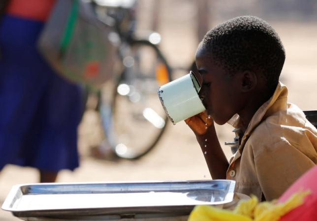 A child drinks water from a cup in drought-hit Masvingo, Zimbabwe, June 1, 2016. Credit: Reuters File Photo