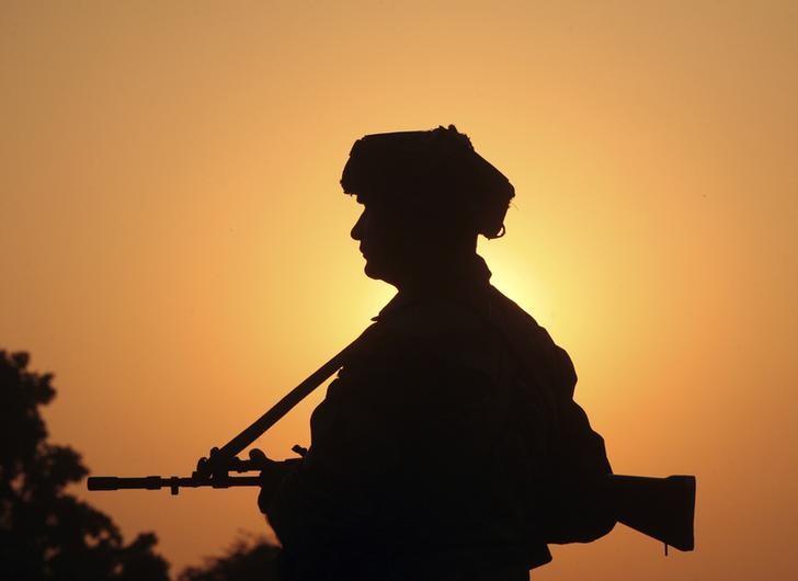 An Indian army soldier at Pindi Khattar village in Arnia, near the border with Pakistan. Credit: Reuters/Mukesh Gupta/Files