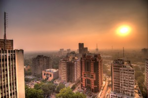 The setting sun over Connaught Place, New Delhi. Credit: wili/Flickr, CC BY 2.0