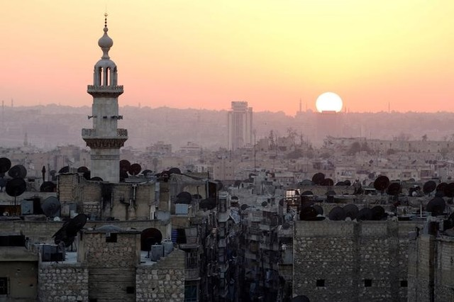 The sun sets over Aleppo as seen from rebel-held part of the city, Syria October 5, 2016. Credit: Abdalrhman Ismail/Reuters/Files