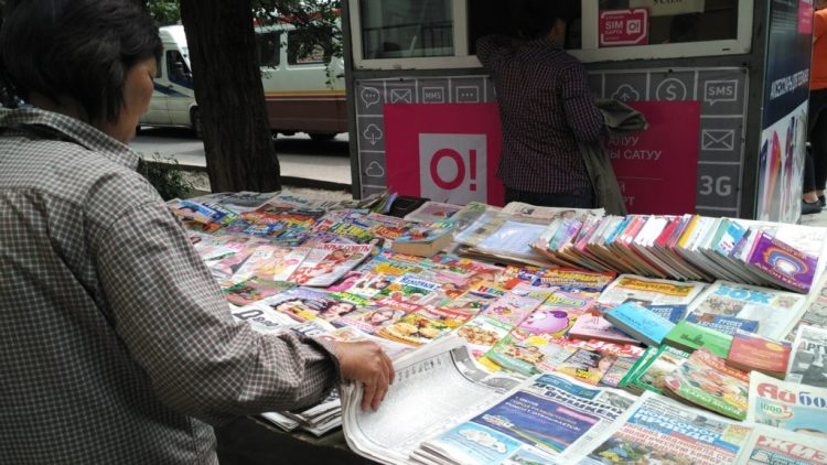 A newspaper stall in Bishkek. With more than 1,500 registered media; 125 newspapers and magazines, 26 radio and 25 TV channels Kyrgyzstan appears to have a vibrant public space. But the content is not so varied. Credit: M. Reyaz