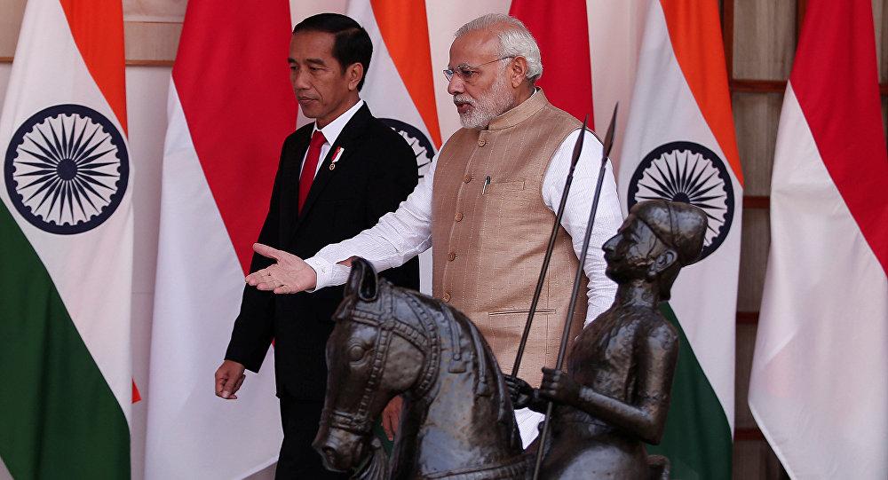 Indonesian President Joko Widodo with Indian Prime Minister Narendra Modi. Credit: Reuters