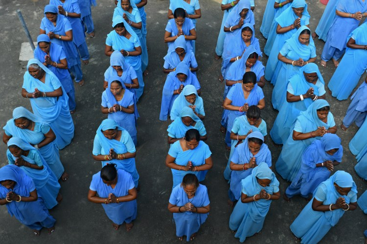 Rehabilitated manual scavengers gather for assembly, attendance and prayer inside a rehabilitation center called Nai Disha run by an NGO , in Alwar, Rajasthan, India on 24 September 2016. Credit: Anindito Banerjee
