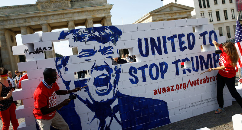 Protestors are tearing down a so called 'Trump's wall of hate' as part of a demonstration against Republican presidential candidate Donald Trump in front of the Brandenburg Gate at the Pariser Platz in Berlin, Germany, Friday, Sept. 23, 2016. Credit: Reuters