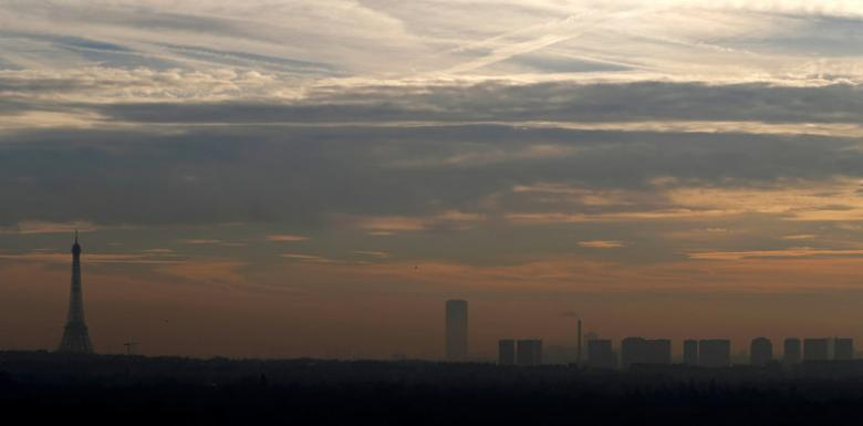 A small-particle haze hangs above the Eiffel Tower, that is seen on the horizon from Suresnes, near Paris, France, December 8, 2016. Credit: Reuters/Christian Hartmann