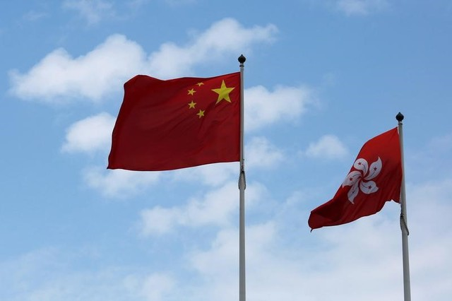 A Chinese national flag and a Hong Kong flag fly outside the Legislative Council in Hong Kong, China November 7, 2016, as China's parliament passed an interpretation of Hong Kong's Basic Law on Monday that says lawmakers must swear allegiance to the city as part of China. Credit: Bobby Yip/Reuters