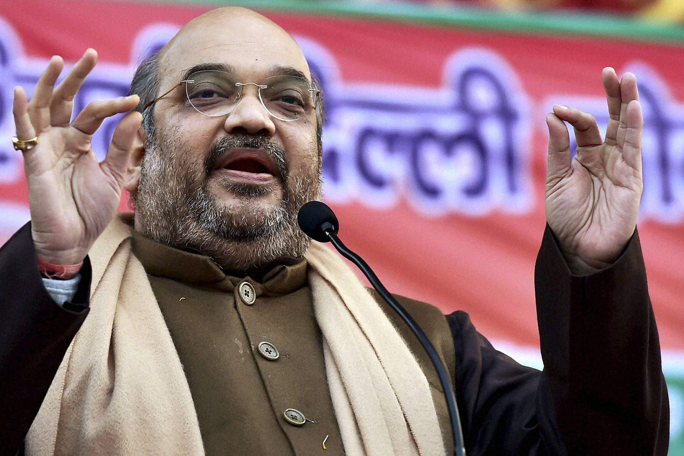 Amit Shah calls Mahatma 'chatur baniya' Congress demands apology