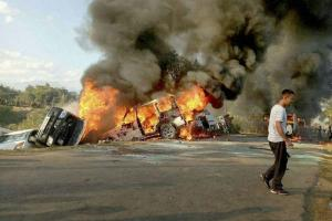 Vehicles set on fire during the blockade in Manipur. Credit: PTI