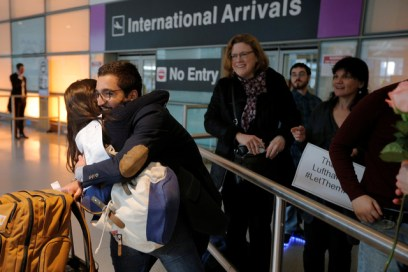 Behnam Partopour, a Worcester Polytechnic Institute (WPI) student from Iran, is greeted by his sister Bahar (L) at Logan Airport after he cleared U.S. customs and immigration on an F1 student visa in Boston, Massachusetts, U.S. February 3, 2017. Partopour was originally turned away from a flight to the U.S. following U.S. President Donald Trump's executive order travel ban. REUTERS/Brian Snyder