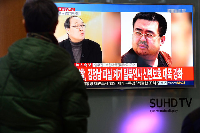 People watch a TV screen broadcasting a news report on the assassination of Kim Jong Nam, the older half brother of the North Korean leader Kim Jong Un, at a railway station in Seoul, South Korea, February 14, 2017. Credit: Reuters