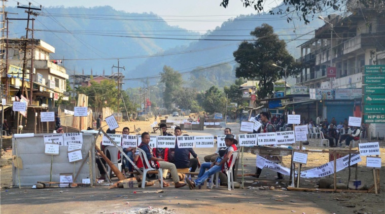 Bandh supporters block the highway during a strike call given by Joint Coordination Committee against 33% women's reservation and killing of two person in police firing in Dimapur, Nagaland on Friday. Credit: PTI